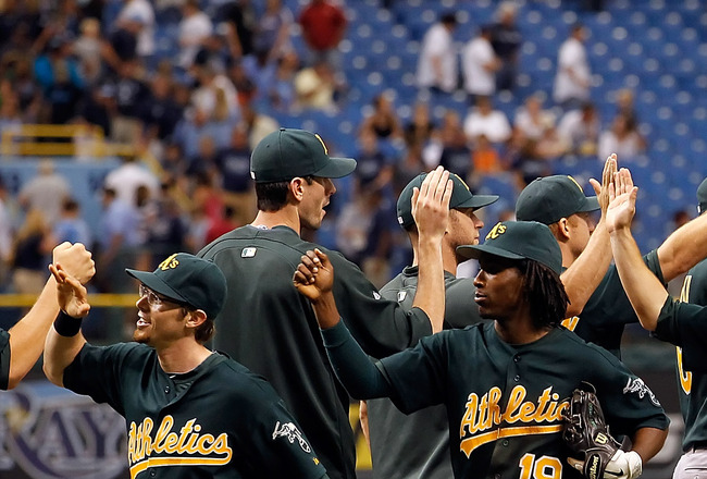 ST. PETERSBURG, FL - AUGUST 07:  Infielders Eric Sogard #36, Jemile Weeks #12, Scott Sizemore #29 and Adam Rosales #7 of the Oakland Athletics celebrate their team's victory over the Tampa Bay Rays at Tropicana Field on August 7, 2011 in St. Petersburg, F