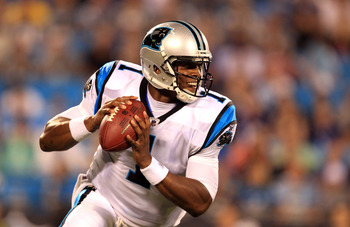 CHARLOTTE, NC - AUGUST 13:  Cam Newton #1 of the Carolina Panthers runs with the ball during their preseason game against the New York Giants at Bank of America Stadium on August 13, 2011 in Charlotte, North Carolina.  (Photo by Streeter Lecka/Getty Image
