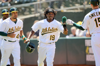 OAKLAND, CA - AUGUST 17:  Coco Crisp #4 and Jemile Weeks #19 of the Oakland Athletics run back to the dugout after they both scored on a double by Josh Willingham #16 of the Oakland Athletics in the first inning of their game against the Baltimore Orioles