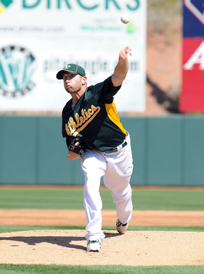 PHOENIX, AZ - MARCH 04:  Dallas Braden #51 of the Oakland Athletics delivers a pitch against the Texas Rangers at Phoenix Municipal Stadium on March 4, 2011 in Phoenix, Arizona.  (Photo by Norm Hall/Getty Images)
