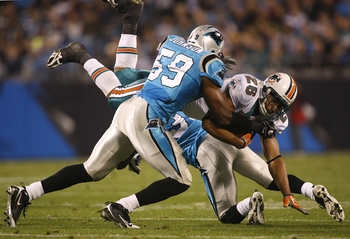 CHARLOTTE - NOVEMBER 19: Lex Hilliard #26 of the Carolina Panthers is tackled by against Landon Johnson #59  and Richard Marshall #31 of the Miami Dolphins at Bank of America Stadium on November 19, 2009 in Charlotte, North Carolina.  (Photo by Streeter L