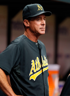 ST. PETERSBURG, FL - AUGUST 06:  Manager Bob Melvin #6 of the Oakland Athletics directs his team against the Tampa Bay Rays during the game at Tropicana Field on August 6, 2011 in St. Petersburg, Florida.  (Photo by J. Meric/Getty Images)