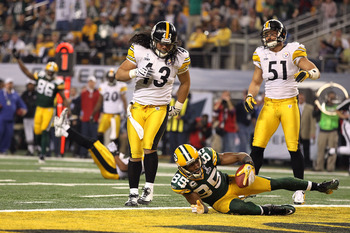 ARLINGTON, TX - FEBRUARY 06:  Greg Jennings #85 of the Green Bay Packers reacts after catching a 21 yard pass for a touchdown against Troy Polamalu #43 and James Farrior #51 of the Pittsburgh Steelers during Super Bowl XLV at Cowboys Stadium on February 6