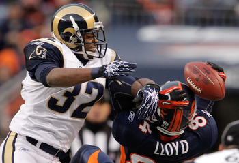 DENVER - NOVEMBER 28:  Corner back Bradley Fletcher #32 of the St. Louis Rams breaks up a pass intended for wide receiver Brandon Lloyd #84 of the Denver Broncos in the second quarter at INVESCO Field at Mile High on November 28, 2010 in Denver, Colorado.