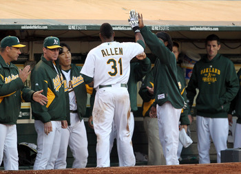 OAKLAND, CA - AUGUST 16:  Brandon Allen #31 of the Oakland Athletics is congratulated by teammates after scoring in the second inning of their game against the Baltimore Orioles at O.co Coliseum on August 16, 2011 in Oakland, California.  (Photo by Ezra S