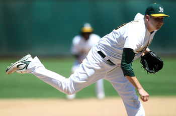 OAKLAND, CA - AUGUST 13:  Trevor Cahill #53 of the Oakland Athletics pitches against the Texas Rangers at O.co Coliseum on August 13, 2011 in Oakland, California.  (Photo by Jed Jacobsohn/Getty Images)