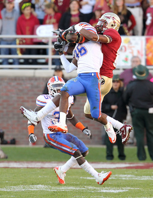 TALLAHASSEE, FL - NOVEMBER 27: Moses Jenkins #36 of the Florida Gators almost intercepts a pass intended for Taiwan Easterling #8 of the Florida State Seminoles during a game at Doak Campbell Stadium on November 27, 2010 in Tallahassee, Florida.  (Photo b