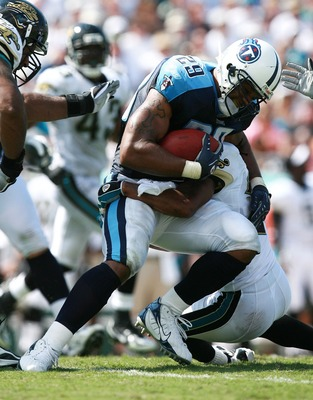 JACKSONVILLE, FL - SEPTEMBER 9:  Running back Chris Brown #29 of the Tennessee Titans is brought down by Reggie Nelson #25 of the Jacksonville Jaguars at Alltel Stadium September 9, 2007 in Jacksonville, Florida.  (Photo by Doug Benc/Getty Images)
