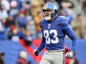 EAST RUTHERFORD, NJ - DECEMBER 05:  Michael Clayton #83 of the New York Giants fires up the crowd prior to the opening kick off against the Washington Redskins on December 5, 2010 at the New Meadowlands Stadium in East Rutherford, New Jersey.  (Photo by J