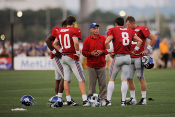 EAST RUTHERFORD, NJ - AUGUST 08:  Quarterback coach Mike Sullivan of the New York Giants speaks Eli Manning #10, David Carr #8, Ryan Perrilloux #5, and Sage Rosenfels #18 take part in practice at New Meadowlands Sports Complex on August 8, 2011 in East Ru