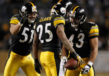 PITTSBURGH, PA - JANUARY 15:  Safety Ryan Clark #25 of the Pittsburgh Steelers celebrates with teammates James Farrior #51 and Troy Polamalu #43 after an interception of quarterback Joe Flacco #5 of the Baltimore Ravens in the third quarter of the AFC Div