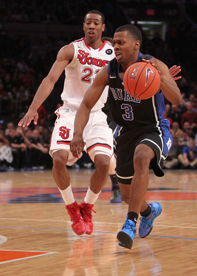 NEW YORK, NY - JANUARY 30: Tyler Thornton #3 of the Duke Blue Devils dribbles the ball against Paris Horne #23 of the St. John's Red Storm at Madison Square Garden on January 30, 2011 in New York City.  (Photo by Nick Laham/Getty Images)
