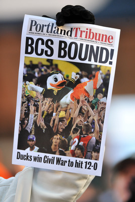 CORVALLIS, OR - DECEMBER 4: A fan holds up a copy of a mock front page after game between the Oregon Ducks and the Oregon State Beavers at Reser Stadium on December 4, 2010 in Corvallis, Oregon. The Ducks beat the Beavers 37-20 to likely go on to the BCS
