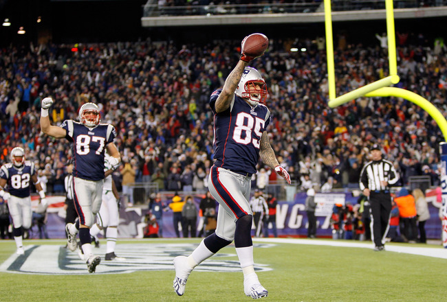 FOXBORO, MA - DECEMBER 06:  Aaron Hernandez #85 of the New England Patriots scores a 1-yard touchdown reception in the fourth quarter against the New York Jets at Gillette Stadium on December 6, 2010 in Foxboro, Massachusetts.  (Photo by Jim Rogash/Getty