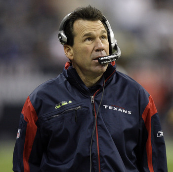 HOUSTON - JANUARY 02: Head coach Gary Kubiak of the Houston Texans checks the scroreboard in the fourth quarter during action against the Jacksonville Jaguars at Reliant Stadium on January 2, 2011 in Houston, Texas.  (Photo by Bob Levey/Getty Images)