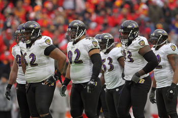 KANSAS CITY, MO - JANUARY 09:  Terrence Cody #62, Haloti Ngata #92, Jameel McClain #53, Cory Redding #93 and Ray Lewis #52 and the Baltimore Ravens defense prepare to face the Kansas City Chiefs during their 2011 AFC wild card playoff game at Arrowhead St