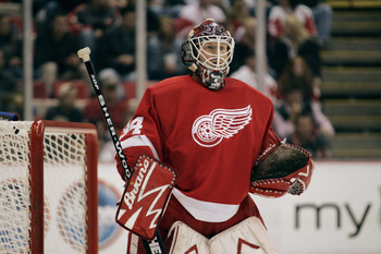 DETROIT - NOVEMBER 11:  Manny Legace #34 of the Detroit Red Wings get set to make a save against the Minnesota Wild during the NHL game on November 11, 2005 at Joe Louis Arena in Detroit, Michigan.  The Red Wings defeated the Wild 3-1.  (Photo By Gregory