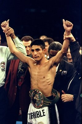 13 Feb 1999:  Erik Morales wears the winners belt after knocking out  Angel Chacon at Thomas & Mack Center in Las Vegas, Nevada. Mandatory Credit: Al Bello  /Allsport