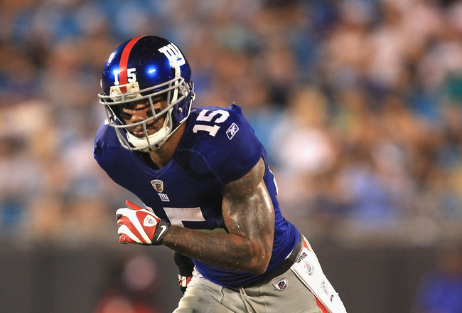 CHARLOTTE, NC - AUGUST 13:  Devin Thomas #15 of the New York Giants against the Carolina Panthers during their preseason game at Bank of America Stadium on August 13, 2011 in Charlotte, North Carolina.  (Photo by Streeter Lecka/Getty Images)