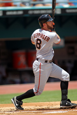 MIAMI GARDENS, FL - AUGUST 14: Jeff Keppinger #8  of the San Francisco Giants singles against the Florida Marlins at Sun Life Stadium on August 14, 2011 in Miami Gardens, Florida.  (Photo by Marc Serota/Getty Images)