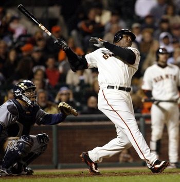 SAN FRANCISCO - AUGUST 24:  Barry Bonds #25 of the San Francisco Giants hits his 761st home run off of Chris Capuano the Milwaukee Brewers during the fourth inning of a game August 24, 2007 at AT&T Park in San Francisco, California.   (Photo by Dino Vourn