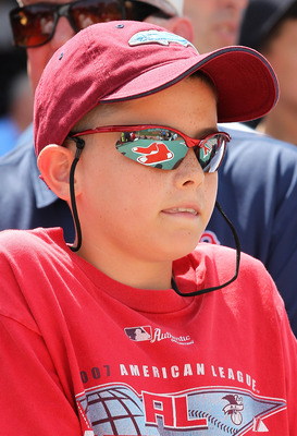 BOSTON, MA  - JULY 28:  A fan of the Boston Red Sox looks on before a game against the Kansas City Royals at Fenway Park on July 28, 2011 in Boston, Massachusetts.  (Photo by Jim Rogash/Getty Images)