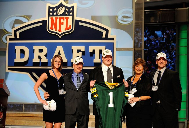 NEW YORK - APRIL 22:  Bryan Bulaga from the Iowa Hawkeyes holds up a Green Bay Packers jersey as he poses with friends and family after the Packers drafted him number 23 overall during the first round of the 2010 NFL Draft at Radio City Music Hall on Apri