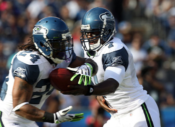 SAN DIEGO, CA - AUGUST 11:  Quarterback Tarvaris Jackson #7 of  the Seattle Seahawks gives the ball to teammate runningback Marshawn Lynch #24 against the San Diego Chargers during their  NFL preseason game on August 11, 2011 at Qualcomm Stadium in San Di