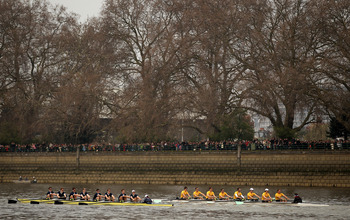LONDON, ENGLAND - MARCH 26:  The Goldies and Isis teams race ahead of the 157th Oxford and Cambridge University Boat Race on the River Thames on March 26, 2011 in London, England.  (Photo by Richard Heathcote/Getty Images)