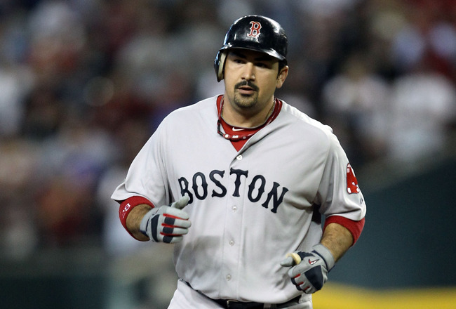 PHOENIX, AZ - JULY 12:  American League All-Star Adrian Gonzalez #28 of the Boston Red Sox runs the bases after hitting a home run in the fourth inning of the 82nd MLB All-Star Game at Chase Field on July 12, 2011 in Phoenix, Arizona.  (Photo by Christian