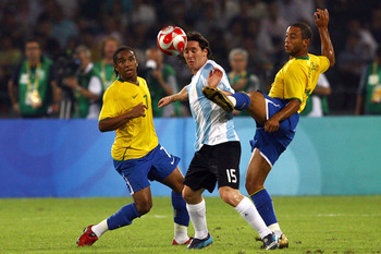 BEIJING - AUGUST 19:  Lionel Messi of Argentina is challenged by Anderson and Alex Silva of Brazil during the men's football semifinal match between Argentina and Brazil at Workers' Stadium on Day 11 of the Beijing 2008 Olympic Games on August 19, 2008 in