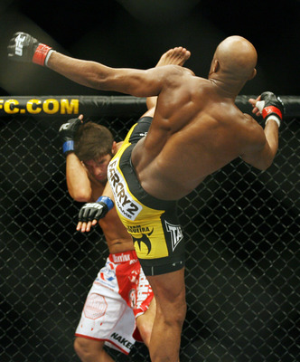CHICAGO- OCTOBER 25:  Anderson Silva fights Patrick Cote in the Middleweight Title Bout at UFC's Ultimate Fight Night at Allstate Arena on October 25, 2008 in Chicago, Illinois. (Photo by Tasos Katopodis/Getty Images)