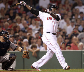 BOSTON, MA - AUGUST 08:  David Ortiz #34 of the Boston Red Sox hits a double in the 10th inning as Russell Martin #55 of the New York Yankees defends on August 8, 2011 at Fenway Park in Boston, Massachusetts.The Boston Red Sox defeated the New York Yankee