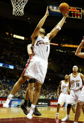 CLEVELAND - FEBRUARY 20:  Carlos Boozer #1 of the Cleveland Cavaliers grabs a rebound against the San Antonio Spurs on February 20, 2004 at Gund Arena in Cleveland, Ohio.  NOTE TO USER: User expressly acknowledges and agrees that, by downloading and or us