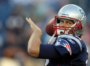 FOXBORO, MA - AUGUST 11:  Tom Brady #12 of the New England Patriots competes before a game against the Jacksonville Jaguars at Gillette Stadium on August 11, 2011 in Foxboro, Massachusetts. (Photo by Jim Rogash/Getty Images)
