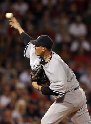 BOSTON, MA - AUGUST 07:  Freddy Garcia #36 of the New York Yankees delivers a pitch in the first inning against the Boston Red Sox on August 7, 2011 at Fenway Park in Boston, Massachusetts.  (Photo by Elsa/Getty Images)