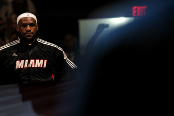 MIAMI, FL - JUNE 12:  LeBron James #6 of the Miami Heat stands for the performance of the National Anthem against the Dallas Mavericks in Game Six of the 2011 NBA Finals at American Airlines Arena on June 12, 2011 in Miami, Florida. NOTE TO USER: User exp
