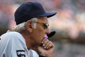 BALTIMORE, MD - APRIL 04:  Jim Leyland #10 manager of the Detroit Tigers looks on from the dugout during the third inning against the Baltimore Orioles during opening day at Oriole Park at Camden Yards on April 4, 2011 in Baltimore, Maryland.  (Photo by R