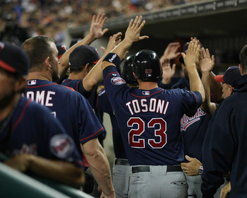 DETROIT, MI - AUGUST 17:  Rene Tosoni #23 of the Minnesota Twins high fives teammates in the dug-out after hitting a home run against the Detroit Tigers during a MLB game at Comerica Park on August 17, 2011 in Detroit, Michigan.  The Twins won 6-5 (Photo