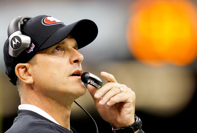 NEW ORLEANS, LA - AUGUST 12: Head Coach Jim Harbaugh of the San Francisco 49ers looks on as his team plays the New Orleans Saints during a preseason game at Louisiana Superdome on August 12, 2011 in New Orleans, Louisiana.  (Photo by Sean Gardner/Getty Im