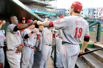 WASHINGTON, DC - AUGUST 16:  Joey Votto #19 of the Cincinnati Reds celebrates with Edgar Renteria #16 after scoring in the first inning against the Washington Nationals at Nationals Park on August 16, 2011 in Washington, DC.  (Photo by Greg Fiume/Getty Im