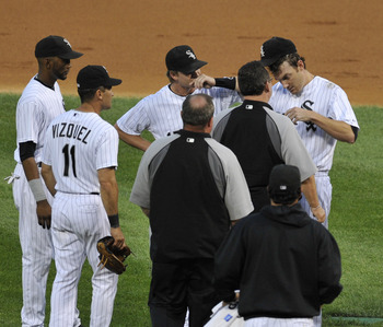 CHICAGO, IL - AUGUST 18:  Philip Humber #41 of the Chicago White Sox (R) speaks with team members after being hit in the head by a line drive off the bat of Kosuke Fukudome of the Cleveland Indians in the second inning on August 18, 2011 at U.S. Cellular