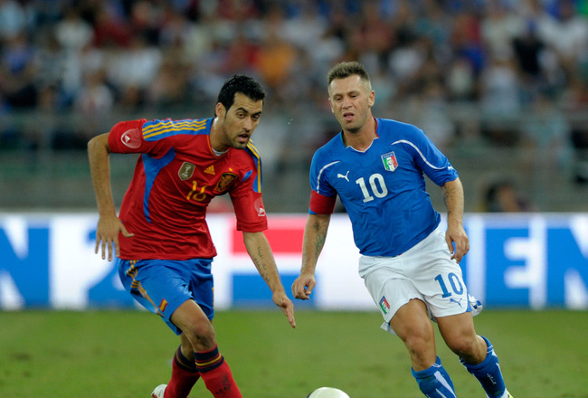 BARI, ITALY - AUGUST 10:  Antonio Cassano of Italy and Sergio Busquets of Spain during the international friendly match between Italy and Spain at Stadio San Nicola on August 10, 2011 in Bari, Italy.  (Photo by Claudio Villa/Getty Images)