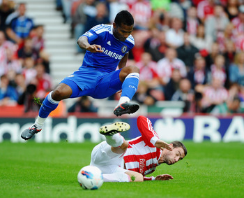 STOKE ON TRENT, ENGLAND - AUGUST 14:  Florent Malouda of Chelsea is tackled by Rory Delap of Stoke during the Barclays Premier League match between Stoke City and Chelsea at the Britannia Stadium on August 14, 2011 in Stoke on Trent, England.  (Photo by L