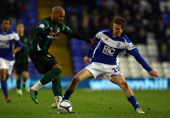 BIRMINGHAM, ENGLAND - JANUARY 29:  Marlon King of Coventry holds off Alexander Hleb of Birmingham during the FA Cup Sponsored by E.ON 4th Round match between Birmingham City and Coventry City at St Andrews on January 29, 2011 in Birmingham, England.  (Pho