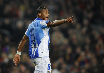 BARCELONA, SPAIN - JANUARY 16:  Julio Baptista of Malaga reacts during the La Liga match between FC Barcelona and Malaga at Nou Camp on January 16, 2011 in Barcelona, Spain. Barcelona won 4-1.  (Photo by David Ramos/Getty Images)