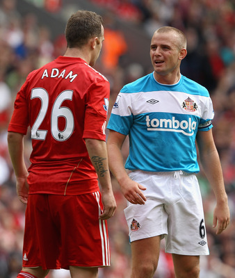 LIVERPOOL, ENGLAND - AUGUST 13:  Lee Cattermole of Sunderland reacts after a challenge by Charlie Adam of Liverpool during the Barclays Premier League match between Liverpool and Sunderland at Anfield on August 13, 2011 in Liverpool, England.  (Photo by C