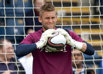 WYCOMBE, ENGLAND - JULY 23: Rob Green of West Ham warms up prior to the Pre Season Friendly match betwen Wycombe Wanderers and West Ham United at Adams Parks on July 23, 2011 in Wycombe, England.  (Photo by Ben Hoskins/Getty Images)