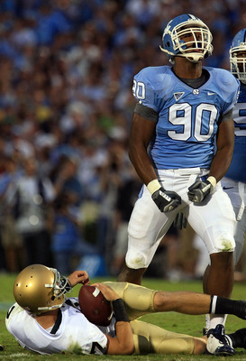 CHAPEL HILL, NC - OCTOBER 11:  Quinton Coples #90 of the North Carolina Tar Heels celebrates after sacking Jimmy Clauson #7 of the Notre Dame Fighting Irish at Kenan Stadium October 11, 2008 in Chapel Hill, North Carolina.  (Photo by Scott Halleran/Getty