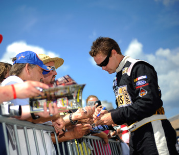 LEBANON, TN - JULY 23: Ricky Stenhouse Jr., driver of the #6 RickyvsTrevor.com Ford, signs autographs for fans during qualifying for the NASCAR Nationwide Series Federated Auto Parts 300 at Nashville Superspeedway on July 23, 2011 in Lebanon, Tennessee. (